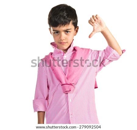 Boy doing bad signal  - stock photo