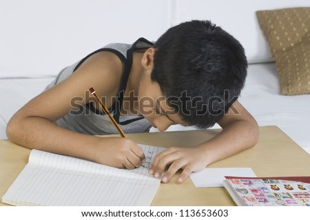 Boy doing homework at desk