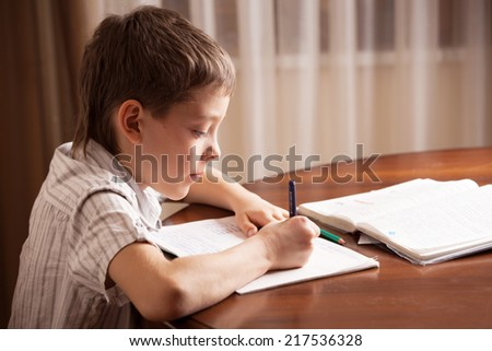 Boy doing homework. Child education - stock photo
