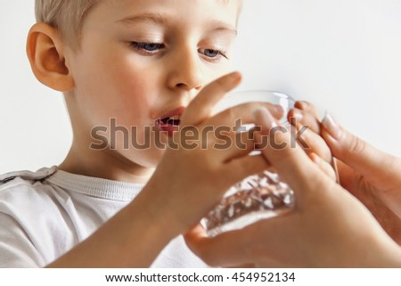 boy drank the juice, holding hands empty glass
