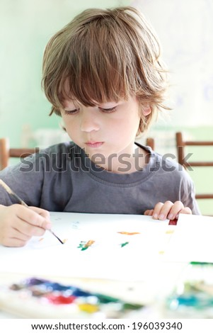 boy draw in home