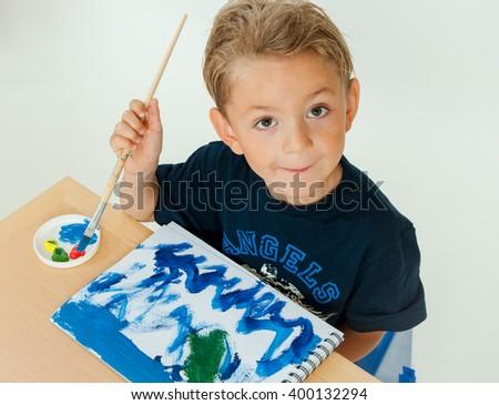 Boy drawing - stock photo