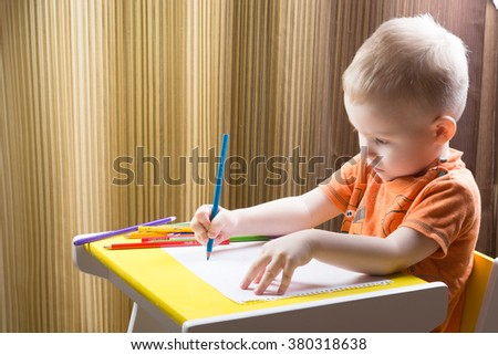 Boy, drawing a picture for fathers day - stock photo