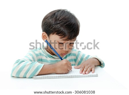 boy drawing colored pencils in a book on white background.