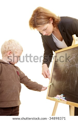 Boy drawing on a blackboard - stock photo