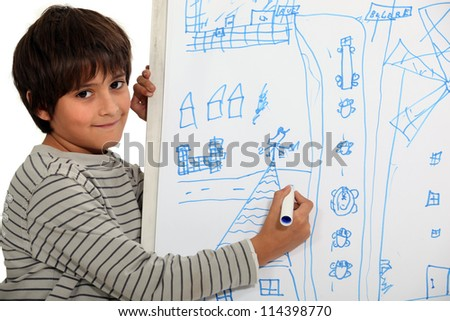 Boy drawing on a whiteboard
