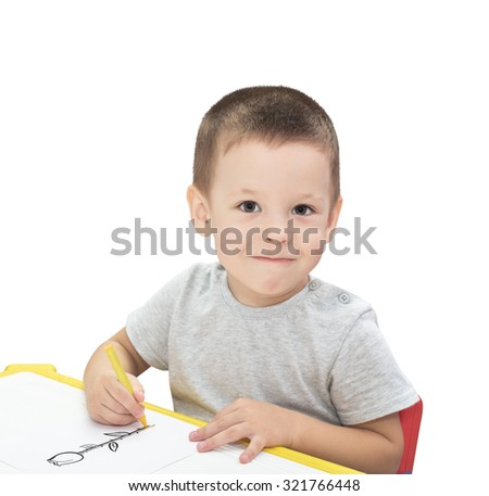 Boy drawing with pencil isolated on the white background - stock photo