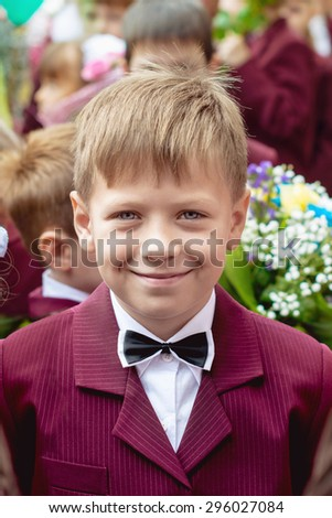 boy dressed as a schoolboy smiling cheerful portrait - stock photo