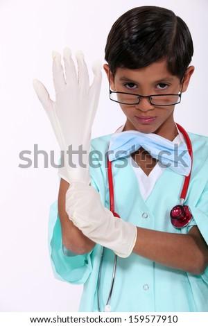 Boy dressed as a surgeon - stock photo