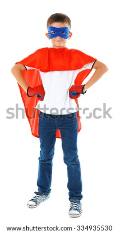 Boy dressed as superhero with boxing gloves poses in studio  isolated on white background - stock photo