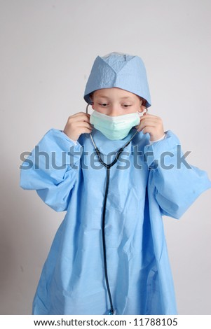 Boy dressed up as surgeon with a stethoscope