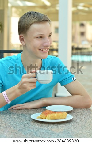 boy drinking coffee in the summer of coffee - stock photo