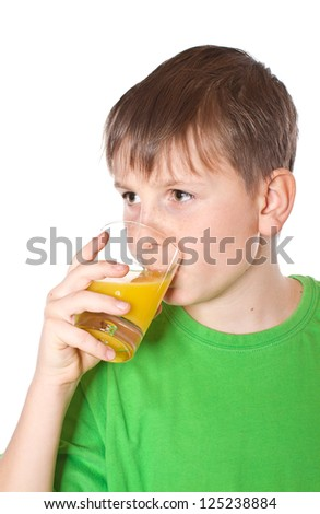 boy drinking orange juice on white background - stock photo