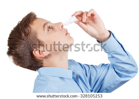 Boy drips medical nose drops for quick recovery. Isolated on white background