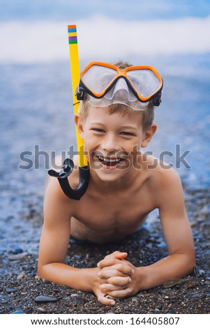 boy  driver on the beach