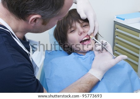 boy during a dental visit. doctor's clinic