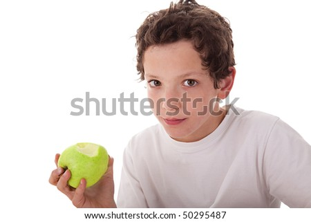 boy eating a green apple, isolated on white background - stock photo