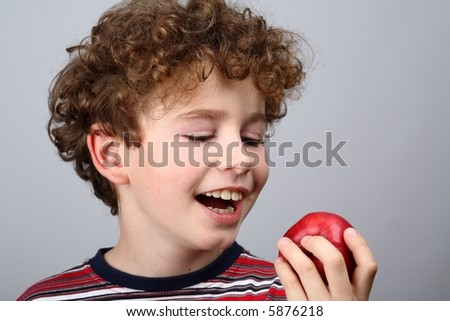 Boy eating an apple - stock photo