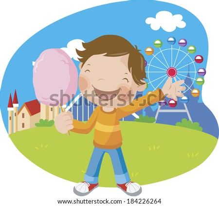 Boy eating cotton candy at the amusement park - stock photo