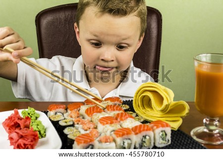 boy eating sushi