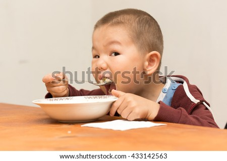 boy eats with gusto