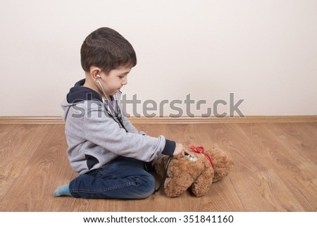 Boy examined the boy teddy bear