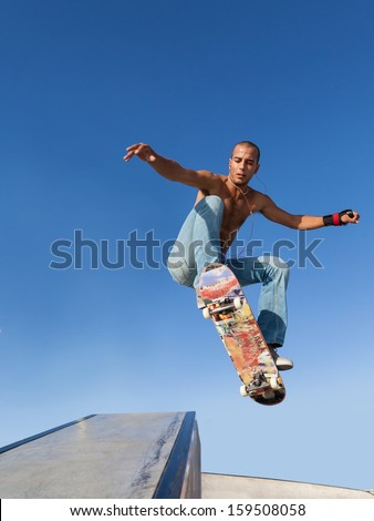 boy flying on a skateboard, sport background - stock photo