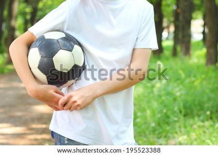 boy football ball in hand - stock photo