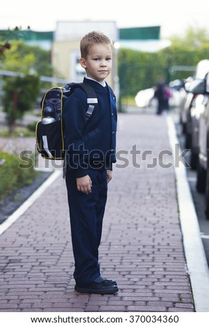 boy for the first time goes to school - stock photo
