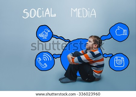 boy frowning sitting on the floor looking up thinking social media infographics sketch Internet - stock photo