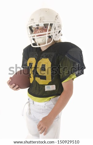 Boy fullback holding American football in uniform - stock photo