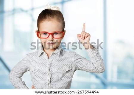 Boy. Genius boy in red glasses near blackboard with formulas - stock photo