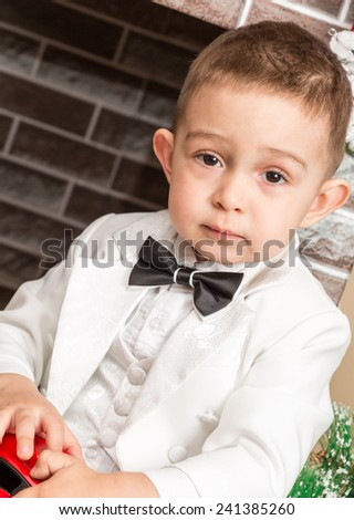 Boy gentleman by fireplace. Christmas and New Year - stock photo