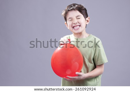 Boy gets air blast from balloon.