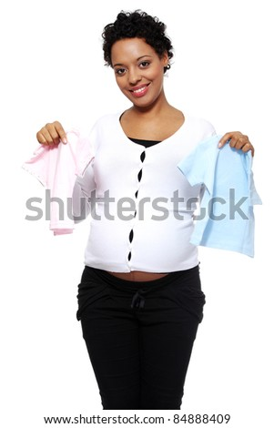 Boy, girl or twins. Pregnant woman holding two bodysuits for a baby (blue and pink) - stock photo