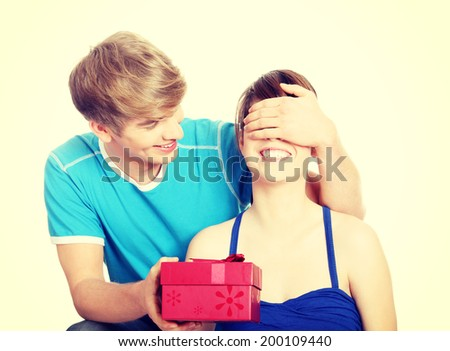 Boy give a gift to his girlfriend - stock photo