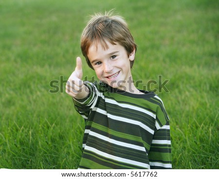 Boy Giving a Thumbs Up - stock photo