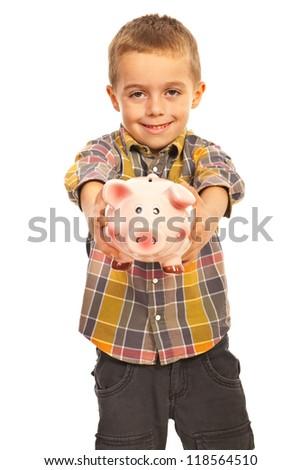 Boy giving piggybank isolated on white background - stock photo