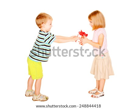 Boy giving to his girl a gift box. Isolated on white background. - stock photo