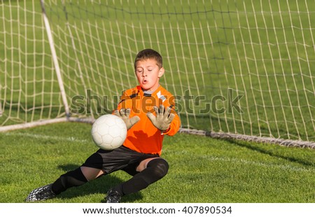 boy goalkeeper defends the goal
