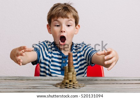 Boy grabbing to take stack of money coins.