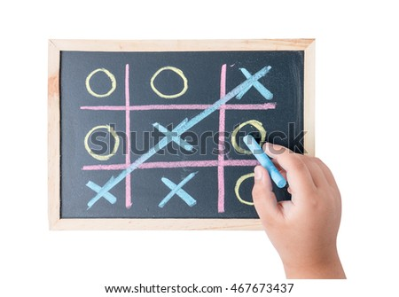 boy hand drawing a game of tic tac toe on a black chalkboard isolated on white background