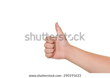 Boy hand showing thumbs up sign against white background