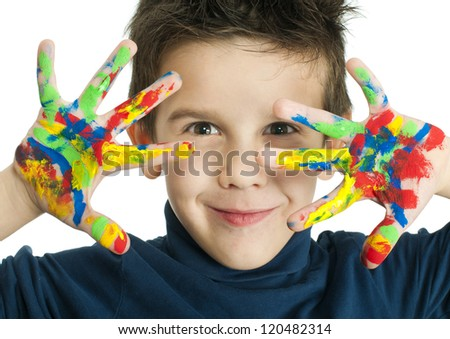 Boy hands painted with colorful paint. White isolated smiling child