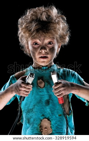 Boy has a electric shock on black background - stock photo