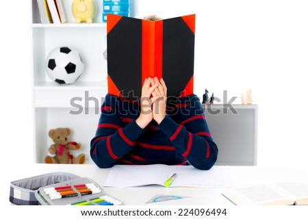 boy has a problem with reading - stock photo