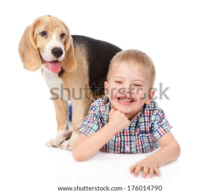 boy has fun with a puppy. isolated on white background - stock photo