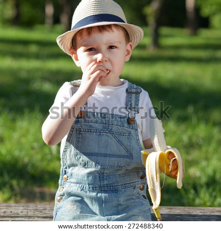 Boy having a snack on a playground - stock photo