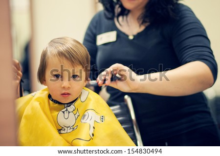 Boy, having haircut - stock photo