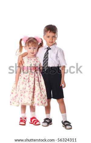Boy hold little girl isolated on white background - stock photo